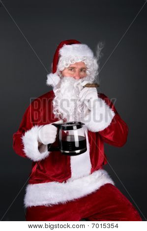 Santa Claus Smoking A Cigar And Drinking Coffee
