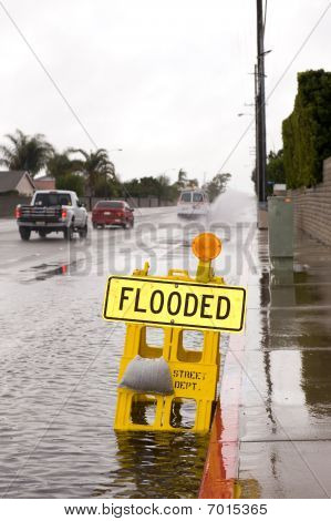 Flooded Street And Sign