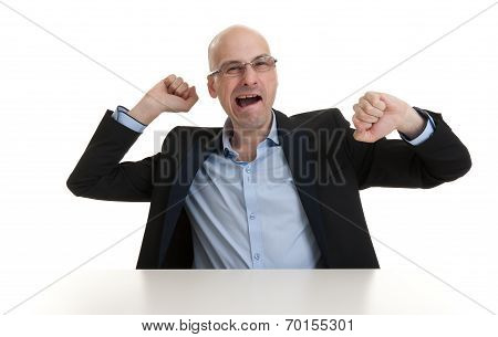 Portrait Of Sleepy Businessman Yawning