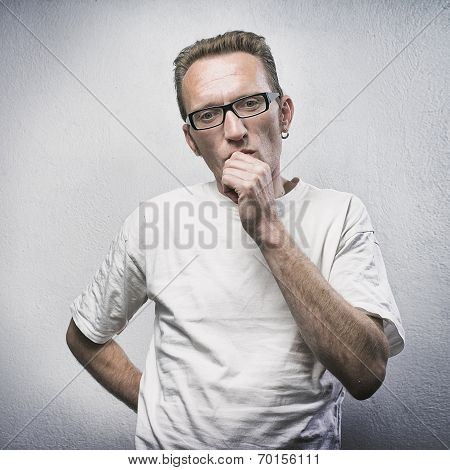 Thinking man on gray textured background