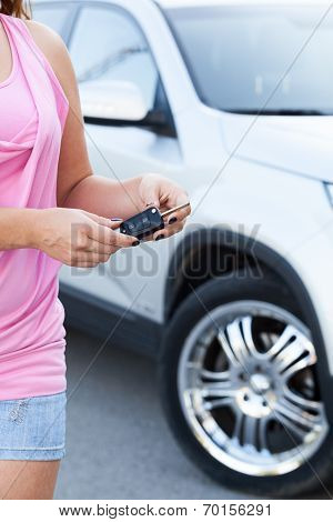 Unrecognizable Woman With Ignition Key Standing Near New Car