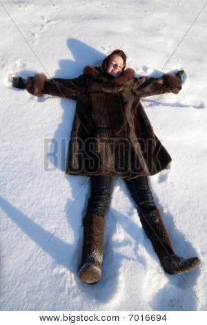 Girl Lying In Snow