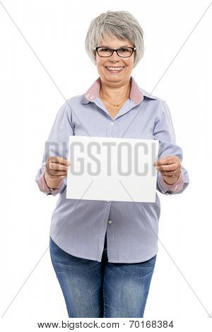 Happy elderly woman holding a blank paper card with copy space for the designer