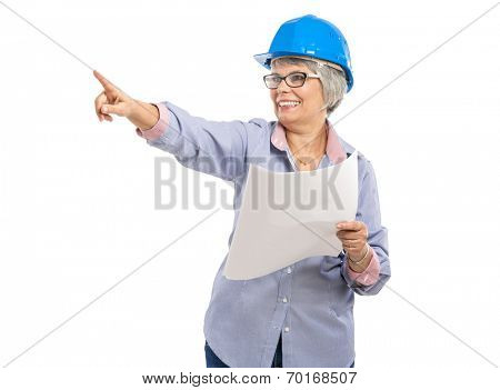 Female architect with a helmet and holding paper projects and pointing