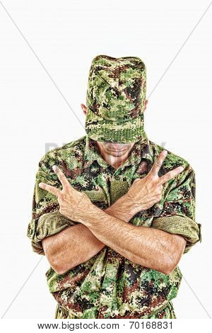 Soldier Standing With Sign Of Peace With Cross Arms