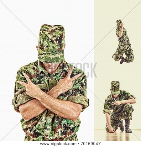 Soldier With Hidden Face In Green Camouflage Uniform Jumping And Showing Peace