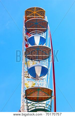 Ferris wheel against a clear blue sky.