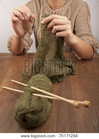 first steps of learning to knit. Knitting