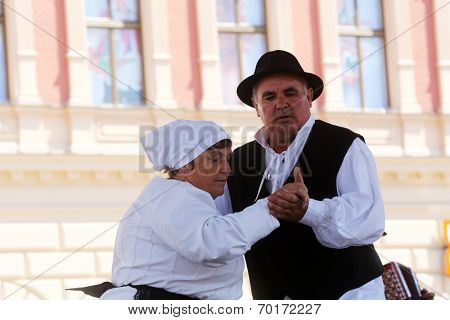 ZAGREB, CROATIA - JULY 20: Members of folk groups St. Jerome from Strigova, Croatia during the 48th International Folklore Festival in center of Zagreb, Croatia on July 20, 2014
