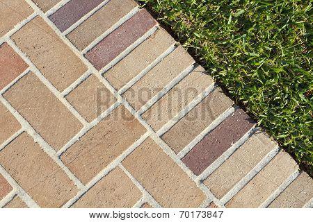Brick Pavers Walkway And Lush Green Grass