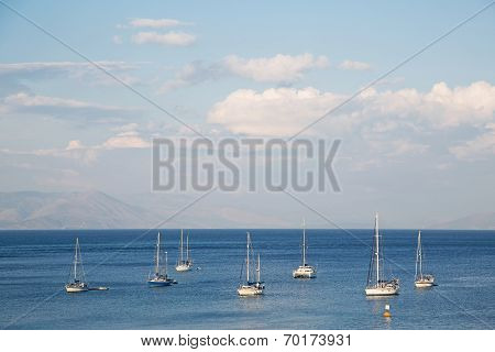 Blue Water And Sky Background On The Ocean With Sailing Boats.