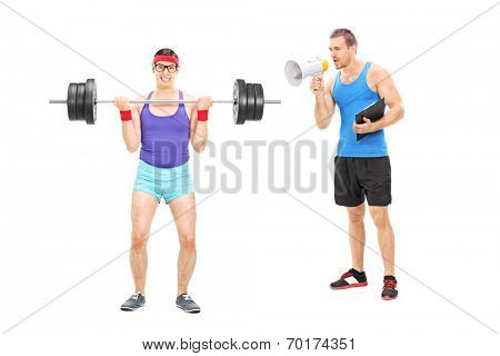 Fitness coach shouting at a nerdy guy through megaphone isolated on white background