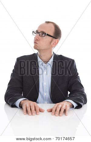 Pensive And Doubtful Isolated Businessman Looking At The Side Wearing Suit.