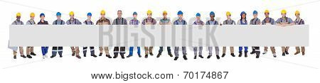 Diverse Manual Workers Holding Blank Billboard