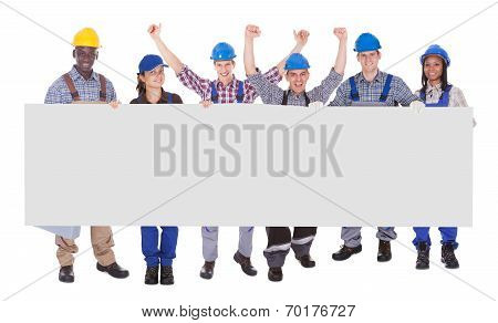Multiethnic Manual Workers Holding Blank Banner