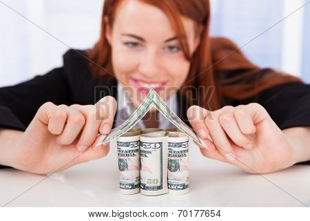Real Estate Agent Making House Of Dollar Bills