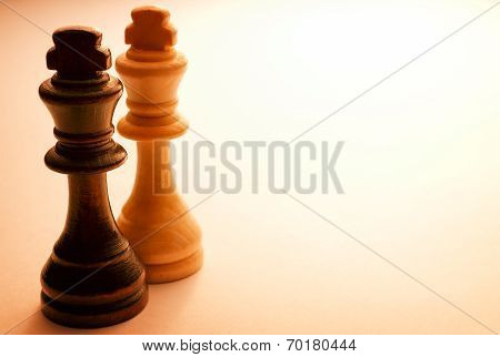 Two Standing Wooden King Chess Pieces