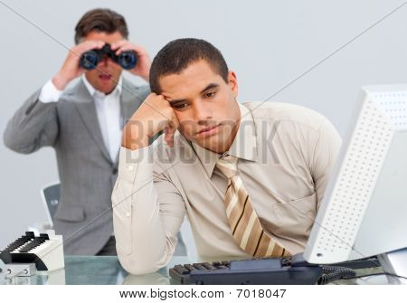 Angry Businessman Annoyed By A Man Looking Through Binoculars