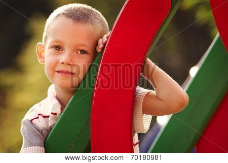Cute Little Boy In A Colorful Kids Playground
