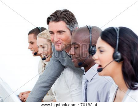 Handsome Manager And His Team Working In A Call Center