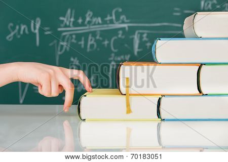 Hand Climbing Stack Books In Classroom
