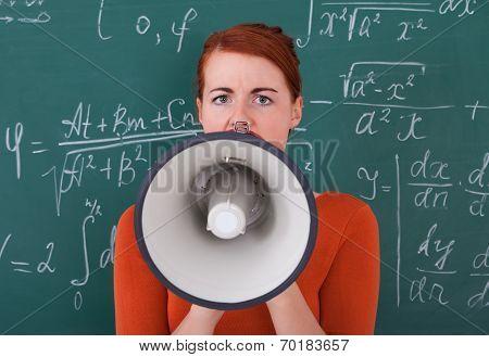 Student Screaming On Megaphone Against Blackboard