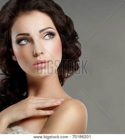 Femininity. Groomed Woman's Face With Natural Makeup. Pure Beauty