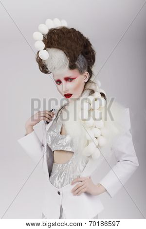 Haute Couture. Extravagant Woman In Cyber Costume And Theatrical Hair-do