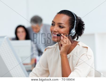 Positive businesswoman talking on headset