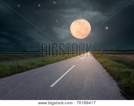 Driving On An Empty Road Towards The Moon