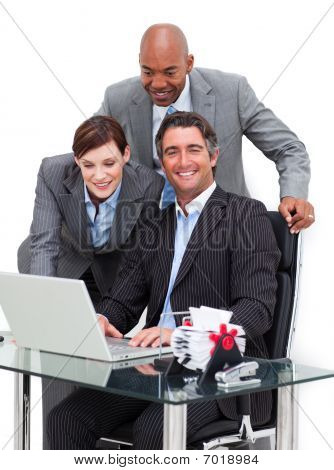 Jolly Business Team Working At A Computer