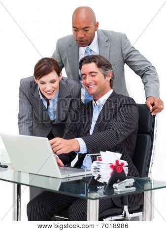 Joyful Businessman Showing Something At Laptop To His Team