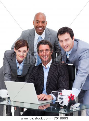 Ambitious Business Team Working At A Computer