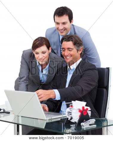 Enthusiastic Business Team Working At A Computer