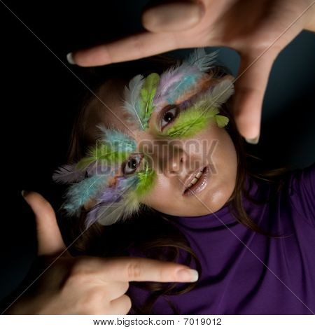 Girl With Colorful Feather On Her Face