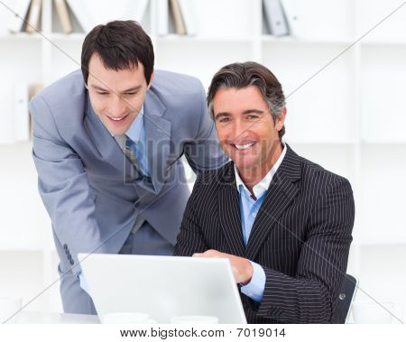 Portrait Of Two Businessmen Working At A Computer