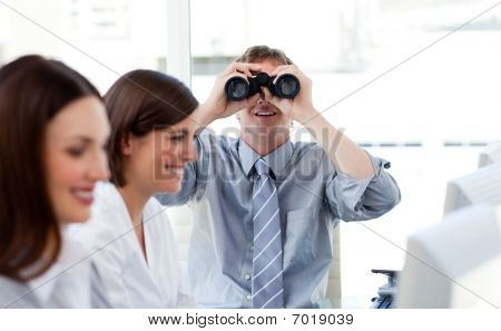 Charismatic Manager Looking Through Binoculars