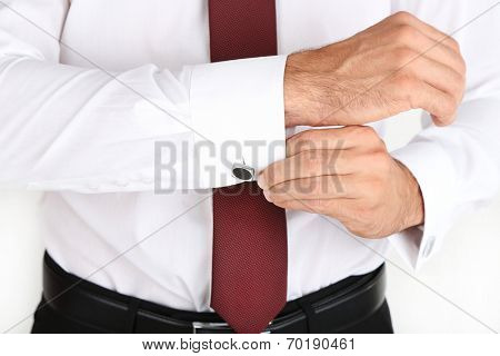Man in white shirt doing collar button up isolated on white