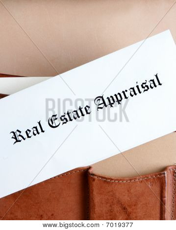 Real Estate Appraisal Documents In A Briefcase