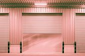 stock photo of red siding  - Shutter door outside factory red color tone - JPG