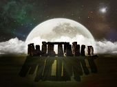 picture of stonehenge  - ruins of Stonehenge at night with a big full moon