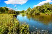stock photo of illinois  - The Kishwaukee River flows through Illinois on a beautiful day - JPG