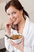 Happy Woman Holding Bowl With Cereals For Breakfast