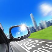 image of speeding car  - Lets go new year 2015 - Drive to city car and rear view mirror on the road concept for business speed or success ** Note: Shallow depth of field - JPG