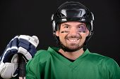 picture of toothless smile  - Funny hockey player smiling bruise around the eye - JPG