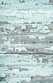 foto of mint-green  - Old rustic background with peeled colour and cracks in mint green color - JPG