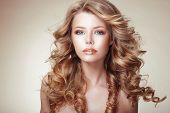 foto of flowing hair  - Portrait of Woman with Beautiful Flowing Bronzed Frizzy Hair - JPG