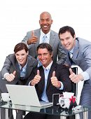 Enthusiastic Business Team With Thumbs Up