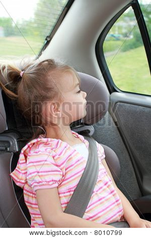 Child Looking Out Car Window