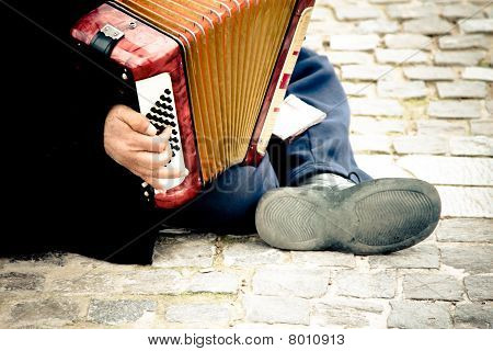 Immigrant Playing Accordion